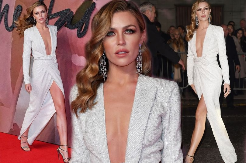 Abbey Clancy flashes acres of cleavage in plunging gown as she ignores fashion 'rules' at awards
