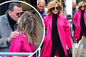 Jennifer Lopez in a hot pink coat as kiss with new fiance Alex Rodriguez in NYC